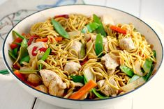 A child friendly chicken noodle stir fry recipe with lots of fresh veggies in a soy honey sauce.