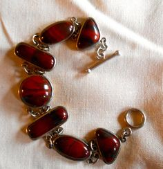 VINTAGE Silver Bracelet with various shapes of by ARMOIREdeKARMA, $159.00