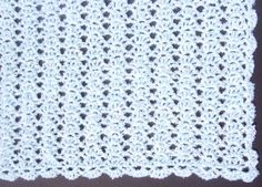 No Beginning Chain Lacy Shell Afghan - free pattern.  The no-beginning-chain is a good technique to learn.  Pattern designed for boucle yarn such as Homespun, but just about any yarn is suitable.  Five different finished sizes given.  Simple pattern with two-row repeat.   . . . .   ღTrish W ~ http://www.pinterest.com/trishw/  . . . .   #crochet #blanket #throw