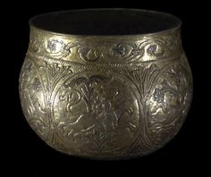Carolingian cup from the Vale of York hoard  9th century  The Vikings loved to hoard. The patterns on this big cup, which twist and gyre ornately as you revolve it, were created in the Carolingian empire but a Viking used it to bury a hoard of silver and gold in the Vale of York. The cup was buried in the earth with the precious things inside it - they came from as far away as Afghanistan, proving how far the Vikings traded.