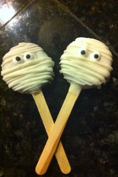Halloween Treats - MUMMY OREOS  Ingredients: Oreos, Vanilla Almond Bark, Popsicle Sticks, Candy Eyeballs (can be found in the cake decorating section near the craft section of walmart)  Directions: Stick a flat popsicle stick in each oreo, dip in white chocolate, press candy eyeballs or m in each one for eyes, let cool, drizzle each one with white chocolate. Freeze until ready to eat!  I will only eat mine frozen!!!!