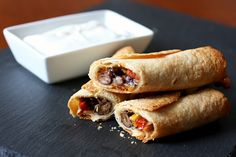 Baked black bean taquitos with avocado dipping sauce.  Just replace with almond flour tortillas to make it even healthier.
