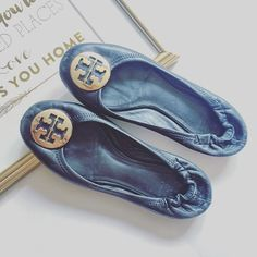 final price Black Tory Burch Reva Flat Worn but still have life left in them! They have the classic elastic back. As seen in the pictures they have wear on the toes and back but is not visible when wearing them! The buckles have some small scratches but overall look great when wearing them! Ask me for more pictures! Does not come with box as this box is for another pair that I own. Gold buckle! Tory Burch Shoes Flats & Loafers