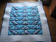 Tæppe i quilt