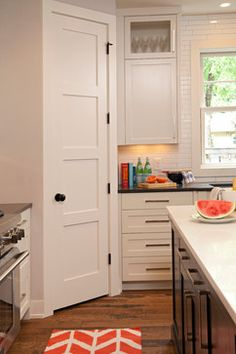 "Classic Contemporary contemporary kitchen. Corner pantry. 2' x 8' door, L shaped shelves 48"" x 12"" and 33"" x 12""."