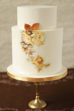 Nicely hand painted wedding cake with flowers