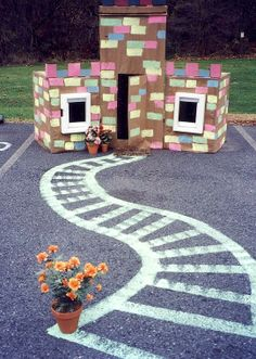 Create a castle with recycled boxes, Crayola Washable Sidewalk Paint, and a good imagination. Write a play script for the stage set, too!