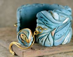 "thatBluCat. I love everything about this. The texture.  The color.  Especially the ""clasp"".  #polymer clay #bracelet #clasp"