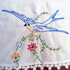 Vintage hand-embroidered tablecloth with bluebirds.
