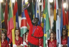 Men's marathon gold medalist Stephen Kiprotich of Uganda marches into closing ceremony of the London 2012 Olympic Games