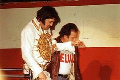 Elvis and Joe make one of their last walks off of the stage - April 22, 1977 in Detroit, Michagan.