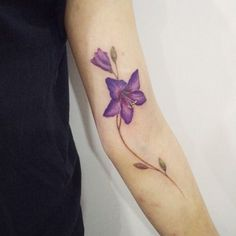 : Violet flower tattoo #tattoo #tattooistdoy #tattooworkers...