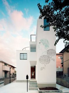 Maria Umievskaya adds ancient drawings to modern japanese homes.  // Umievskaya has visualized the idea, overlaying portraits, flowers and clothing onto the surface of the structure as if it has been hand-painted. the mural-like effect bridges two disciplines and time periods together, creating a mock-urban intervention in suburban japan, from her own studio in kiev.