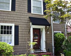 Love the color combo. Taupe, black, white,and a red door.