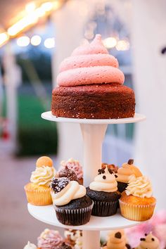 The mega wedding cupcake, just waiting for that first magic bite | Photo credit: Dana Cubbage Weddings, wedding cupcakes: Cupcake DownSouth #weddingcupcakes