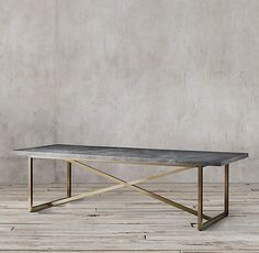 RH's Torano Marble Rectangular Dining Table:Exemplifying the cool minimalism of 1970s Italian design, Torano juxtaposes an austere X-base metal frame with a clean-edged, polished marble top.