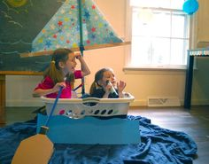 pretend boat made from a laundry basket