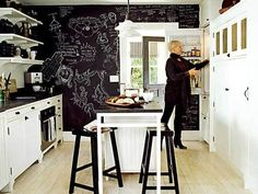 Love this style! Chalkboard kitchen wall. Very out of the box, practical and kid friendly