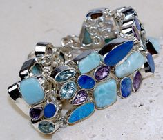 Larimar  ,Amethyst  bracelet designed and created by Sizzling Silver. Please visit  www.sizzlingsilver.com. Product code: BR-8478