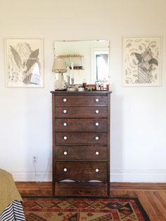 Design*Sponge Sneak Peek This vintage dresser is too small for all my clothes, but it helps me to try to stay minimal. I swapped out the knobs for these milk glass ones and I love the white against the dark wood. I drew the two bat drawings on either side of the mirror. The rug was my grandmother's, and my parents were going to keep it, but it didn't work in their place. I had been coveting it, so was very happy to have it.