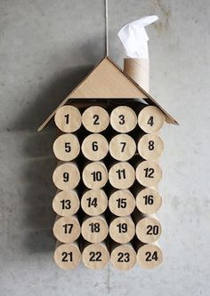These stacked toilet paper tubes make an adorable  recycled house advent calendar and they punch through  for extra fun. Great idea from Morning Creativity.
