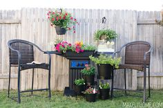 Lovely sitting area with an awesome upcycled BBQ grill turned planter. via @MakelyHome.com