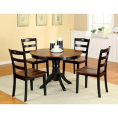 Accessorize your small kitchen or apartment with the five-piece, two-tone Zendell dining set. With a traditional style dining table and comfortable, contoured dining chairs, this set adds a nice contemporary touch to any dining decor.