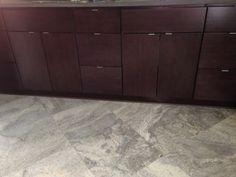 Floor next to cabinets.