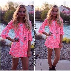 """https://instagram.com/ladycherokeeboutique RESTOCK ALERT!  Our HOTTEST selling Spring Tunic is back in stock!!!! One Last Time Neon PINK & CREAM TUNIC True to size! Chandler is wearing a Small. Can be worn on or off the shoulder! Price: $35.00, Free Shipping Qty: 2-small, 2-medium, 2-large, 4 XL Please comment """"Sold, state, size, and quantity needed, as well as your email to purchase. Also, you must let us know what state you live in, before we can invoice you!"""
