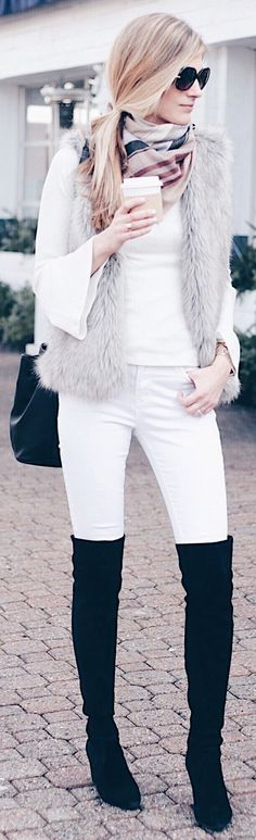#winter #fashion /  White Top / Grey Faux Fur Vest / White Skinny Jeans / Black OTK Boots / Printed Scarf