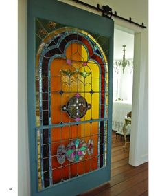 Stained glass barn door, as seen in Houston House & Home, September 2011. I dig the concept, but the paint colors are nothing I'd choose. The glass is pretty though.