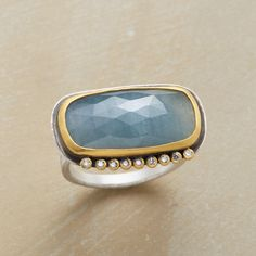 POINT COUNTERPOINT RING--Each diamond plucks glints of iridescence from gray-blue sapphire. Ananda Khalsa wraps the gemstones in matte 22kt gold, oxidized sterling silver. Handmade in USA.