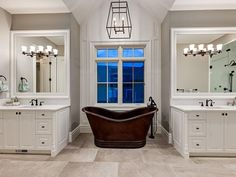 Check out that bath tub! We love the shape and the contrast of its color against the white cabinets. #homedecor