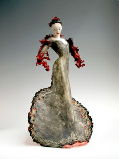 Loie/br18 x 10 x 10 inches/br(Private collection: San Diego)/brPorcelain/stoneware(cone 10) and found & altered metal; stains, underglazes,clear glaze wash./brLoie Fuller, a.k.a. Marie Louise Fuller, revolutionized modern dance at the Exposition Universelle in Paris in 1900 by using yards of silk to transform herself into flowing shapes such as butterflies and flowers. Her pioneering dance and choreography made her the toast of Paris and the veryembodiment of the Art Nouveau movement.
