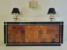 French Pierre Cardin style vintage double sided sideboard c.1970. Smoked mirrored top with walnut doors on a laquered frame.
