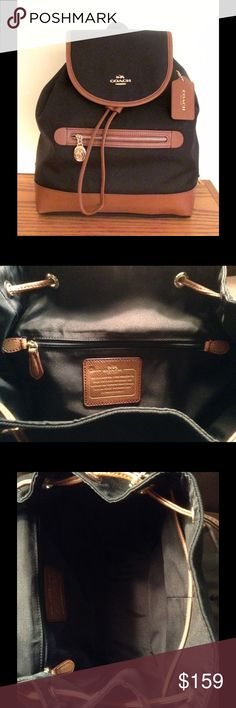 "*NWT* Authentic Coach Sawyer Backpack in Black *NWT* Authentic Coach Sawyer Backpack in Black.  Features: * Black twill fabric with saddle (brown) leather trim * Measures approx. 11 1/4"" (L) x 12 3/4"" (H) x 4 1/4"" (W) * Coach embossed gold-tone hardware * Leather bottom * Interior fully lined  * Two internal leather-trimmed slip pockets on front wall * One internal zippered pocket on back wall Coach Bags Backpacks"