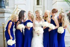 Bridesmaids in royal blue surrounding the bride Elizabeth.