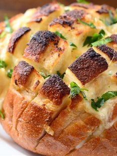 Sourdough bread stuffed with roasted garlic, butter and brie cheese.