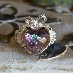 Mystic Rainbow Topaz ring Gorgeous big heart shaped mystic topaz stone beautifully set in a bow topped 925 silver setting Jewelry Rings