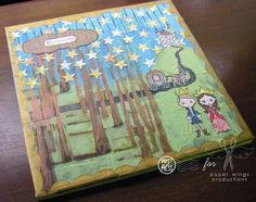 A canvas made using @PaperWingsProd stamps, paint and lots of pattern paper.
