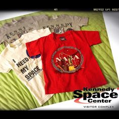 Unisex Kennedy Space Center 4 Tees for little ones Unisex Kennedy Space Center 4 Tees for little ones. Bundled for price of one . Kids size XS.  ( 2 grey tees, 1 white tee and 1 red tee.) No Stains , no tears. Kenny Space Center Authentic Tops Tees - Short Sleeve