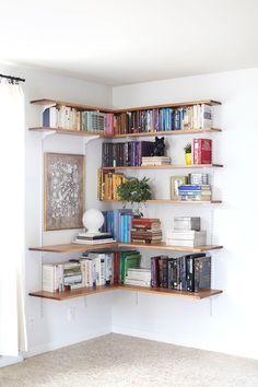 Corner bookcase! Great DIY.