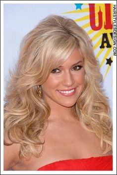 The hair has such volume to it as it is thick and curly. Kristin Cavallari looks sexy with this long hairstyle. Bangs are styled onto the forehead towards one side. The rest of the hair falls in curls long at the front and around at back.  Hair Cut: This is a long haircut that has also been layered.  Hair Colour: The hair is coloured blonde.  Suitable For:  Face shapes: oval, oblong, heart, diamond, round  Hair textu...