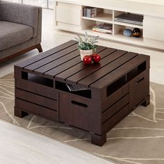 Allow country elegance to blend into your urban decor with this wonderfully unique and stylish piece! The coffee table features handy, hidden and pre-sectioned shelves, along with multiple covert drop-down doors that easily store bulky pieces.