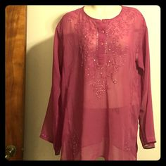 Fuchsia blouse Fuchsia sheer blouse with sequence design on the front ( top and bottom), back, and sleeves. It also have three(3) buttons on the front of the blouse.100% polyester Zero Zero Tops Blouses