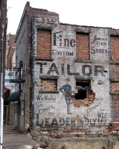 This was an old Tailor Shop advertizement that was painted on the side of a brick building in Logan, WV. It was hidden from 1911 until 2011 by a hotel building and uncovered when that building was torn down. Unfortunately, this building was also torn down and the sign is gone now. It was visible for a brief time before it was destroyed by workman operating heavy machinery too near it. The artist was R. Bishop and it would have been painted sometime prior to 1911. Photo by K Cheek