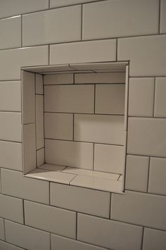 White subway tile with grey grout You had asked me about grey grout.  I do not recommend that look, but here is an example.