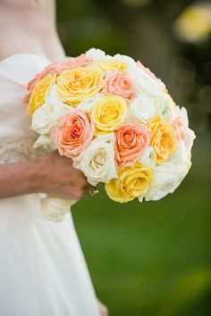 Such a sweet bouquet full up peaches and yellows! {Anna Sawin Photography} Follow @weddingwire for more inspiration!