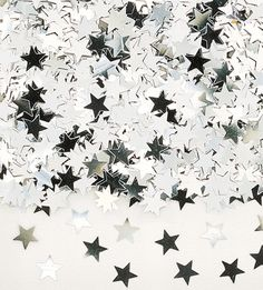 Metallic silver star confetti.  Great for scattering on tables or place in your invitations. £2.50 from the Fuschia Boutique at www.fuschiadesigns.co.uk.