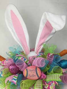 Do you need that perfect centerpiece for your table for Easter?? Well this beautiful Easter deco mesh Bunny Centerpiece is perfect for you. The centerpiece was made in a smoke free home and is made on a 10 inch work form and quality deco mesh is used. It is full of beautiful Easter ribbons and Easter eggs! There are two beautiful butterflies used to give this centerpiece that EXTRA POP!!!. The wonderful extra large bunny ears were made and created by my beautiful mother who also has an Etsy…